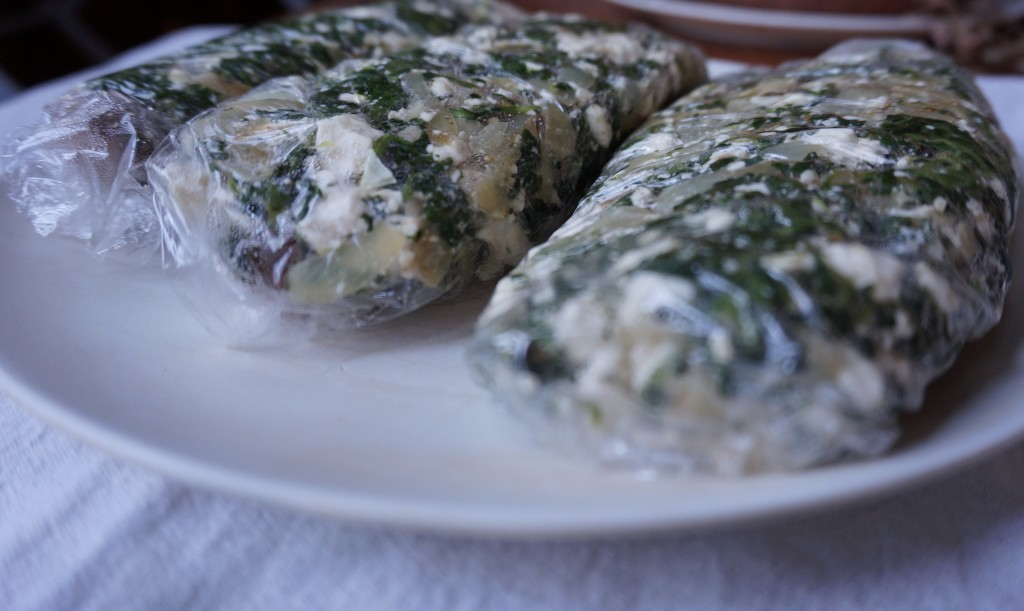 Surround beef with feta-spinach mixture, wrap it in cling wrap, and freeze it for 30-45 minutes so it is easier to work with!